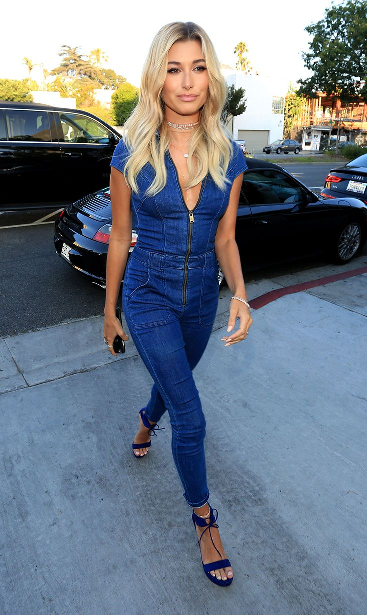 Hailey Baldwin looks seriously dreamy in a blue denim jumpsuit.