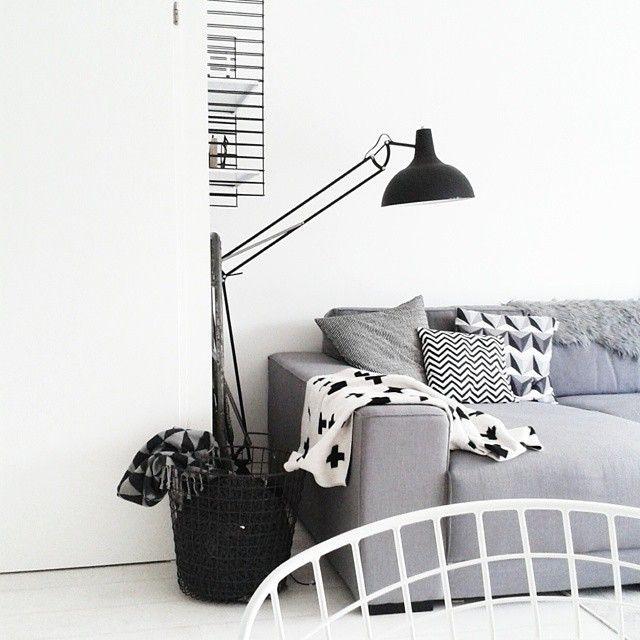 Instagram media by design_script - So simple but so effective - love this styling by @missjettle - #blackandwhite #shadesofgrey #monochrome #monochromehome #crossblanket #livingroom