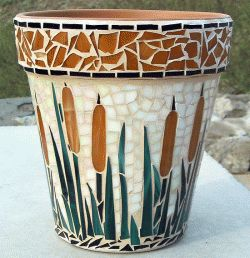 Lots of mosaic tile ideas for the garden on this site - tables, birdbaths, etc,etc!