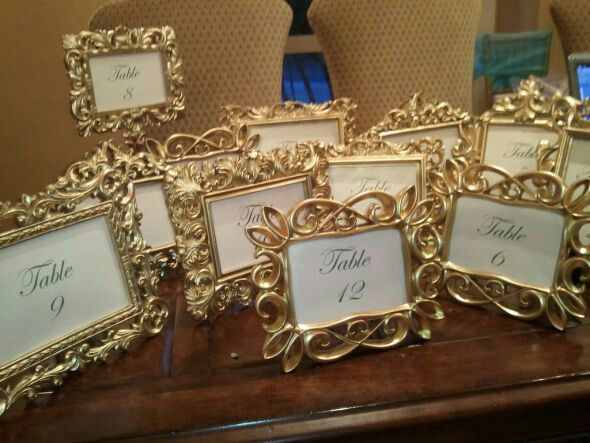 Gold frame table numbers, but instead of numbers,  replace it with king, queen, duke, duchess, princes and princessess' names