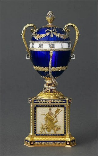 "(1)FABERGE eggs__ Imperial """"Blue Serpent Egg, gift from Emperor Alexander III of Russia to his wife, 1887. The snake is fixed and functions as the hour indicator hand on the clock."