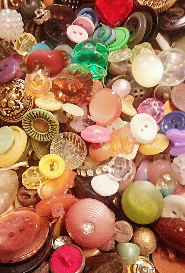 Scoopful of pastel vintage buttons