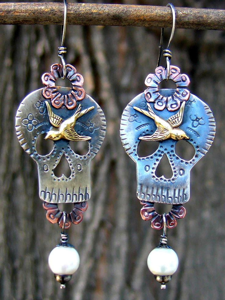 Hand sawed, stamped, forged, and soldered Sugar Skull earrings. Fabricated from sterling silver, copper, brass, and cultured pearl. By Elizabeth Payne ~ Jewelry Arts Studio.