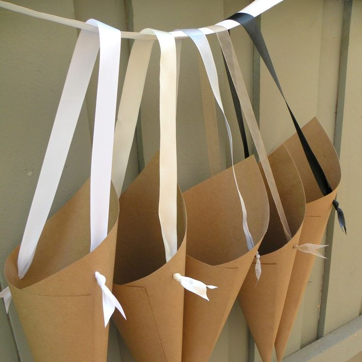 Simple Kraft Paper Wedding Cones with Custom Ribbon Choices for Aisle Decor, Chairs, Church Pew Cones or Flower Girl Petal Basket. $5.00, via Etsy.