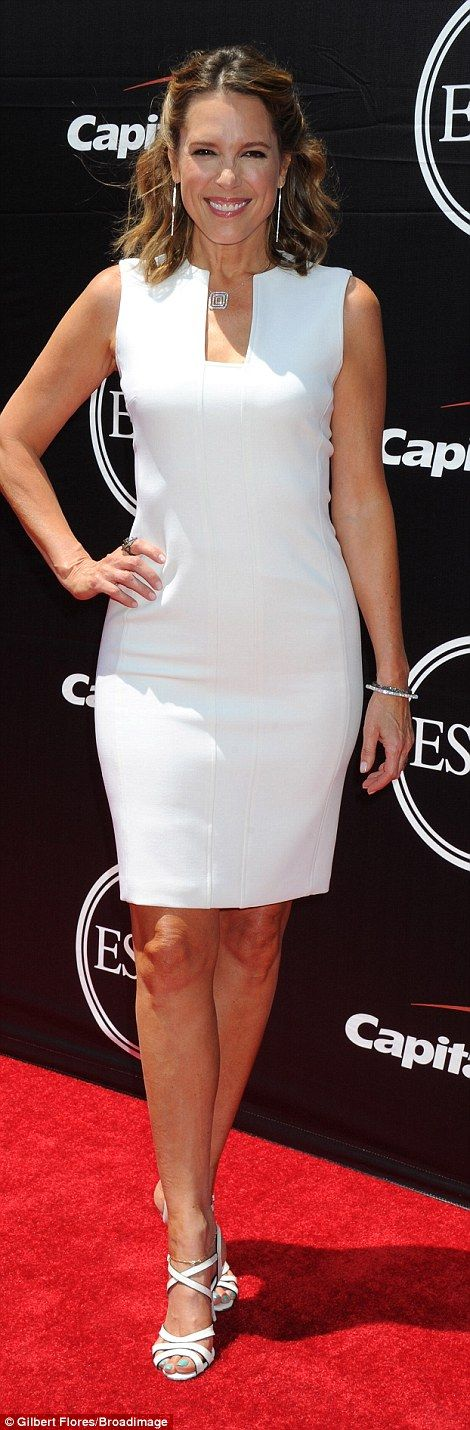 Squaring off: ESPN anchor Hannah Storm wore an above the knee simple white gown with a rec...