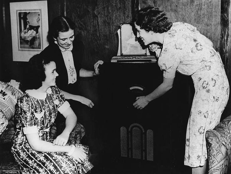 Three young women listening to the radio in Brisbane, ca. 1942. The wireless was the main source of entertainment for many wartime families....