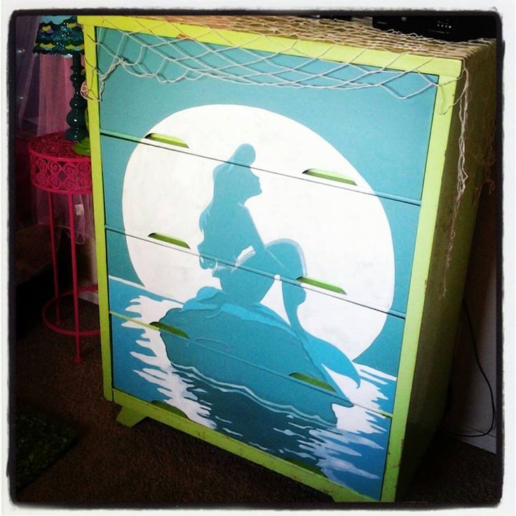 Seeing there is hardly anything when it comes to a mermaid room. I took an old dresser and hand painted a mermaid on the rock with the glow of the moon, <3 It