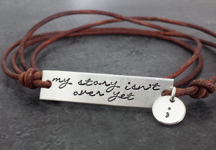 My Story Isn't Over Yet Wrap Bracelet  Our sterling silver and leather wrap bracelet is hand stamped with My Story Isn't Over Yet on a sterling plate and a tiny round disc stamped with a semicolon representing love and hope for those who are struggling with suicide, depression, addiction an