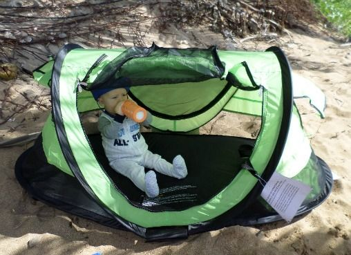 Baby beach gear include beach tents for babies like this portable one by PeaPod.  Folds up and fits in a suitcase so you can travel with it.