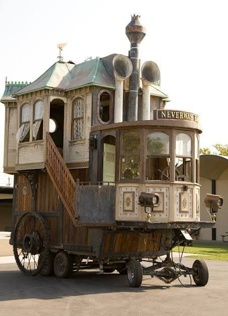 Neverwas Haul, a self-propelled 3-story Victorian House, made from 75% recycled equipment and materials, returns with new interiors, engine, and collections from its travels around the world (i.e., oddities of the Jules Verne era including a Camera Obscura, described below). The Haul measures 24 feet long by 24 feet high and 12 feet wide and is built on the base of a 5 th wheel travel trailer.