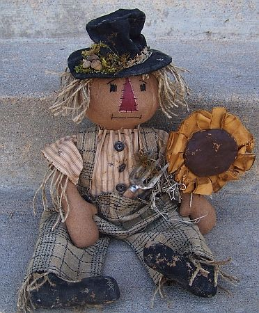 Primitive Scarecrow. Her sit has TONS of patterns for primitive dolls like this. Super cute snowmen for Christmas, scarecrows, etc. fun project!