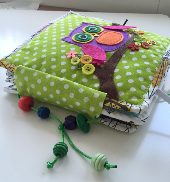This busy book was made for the 3,5 year old boy to develop fine motor skills. Boys mom asked me to make all possible fasteners. The size is 20cm to 20cm. It consists of 6 working pages and 2 cover pages. Dog page  Cute dog will teach your child different kinds of clasps and dogs body parts - eyes, nose, mouth, tongue, ears. You can feed the puppy with a bone and take it for a walk. Crane Its is always fun to be active while playing. Pull the rope and the magnet will pick up the cargo you…