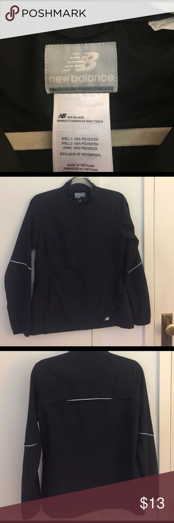New balance black windbreaker. New balance windbreaker. Primarily black with reflective grey stripes on arm and back. Has two side zippered pockets and air vent in the back. Size small but btwn S-M. New Balance Jackets & Coats Utility Jackets