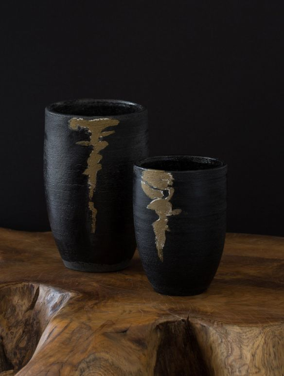 Add an artisan touch to any table or room with handmade ceramics by Haitian craftsman Marithou. Each vase has a one-of-a-kind composition, reflecting the beauty and nature of the Raku process. Ten percent of net proceeds from Haiti Artisan products is donated to the Urban Zen Foundation.