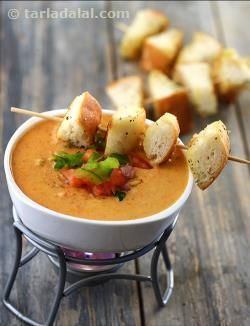 Perfect fondue for the chaat lover! The Pav Bhaji Fondue smartly combines veggies, cheese, cream, milk and pav bhaji masala, into a richly flavoured dip for. The combination of veggies is also such that they offer a perfect blend of crunch, tang and flavour. It is important to serve the Herb Bread and fondue fresh and hot, so that the aroma and flavour are at their best when served.