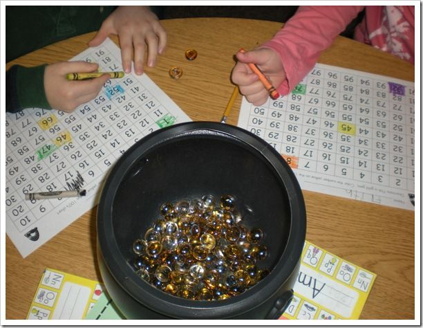Pot 'O Gold game:  you need a cauldron, some gold gems, and a sharpie marker.  Write the number 1-100 on your gold gems, and have the children pull one gem out at a time, find it on their number grid, and color it in.