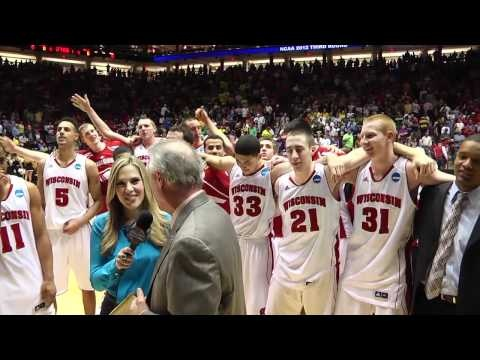 """Members of the Wisconsin men's basketball team sing """"Varsity"""" at mid-court inside The Pit after securing a 60-57 win over Vanderbilt in the third round of the NCAA tournament."""