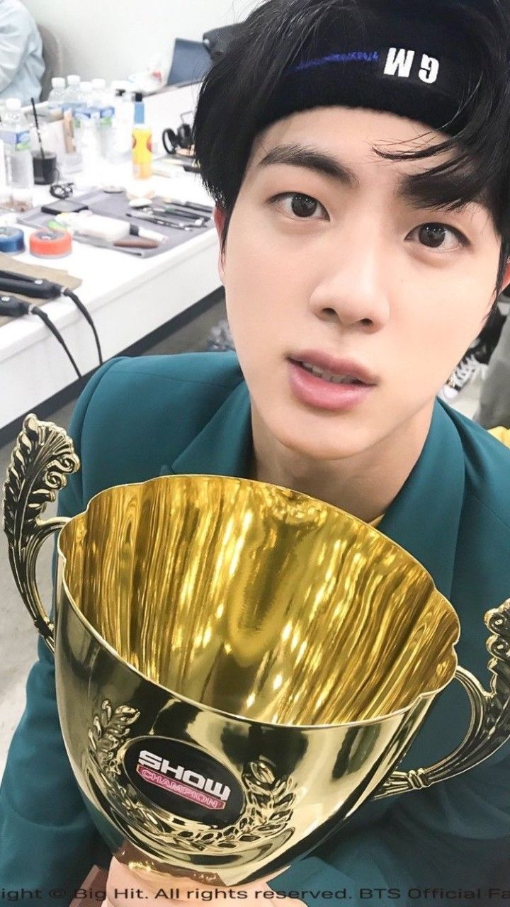 That trophy is beautiful but let's admit Jin is more beautiful.