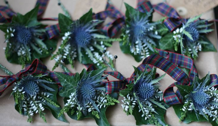 Blue thistle, white heather and tartan buttonholes from The Stockbridge Flower Company, Edinburgh.