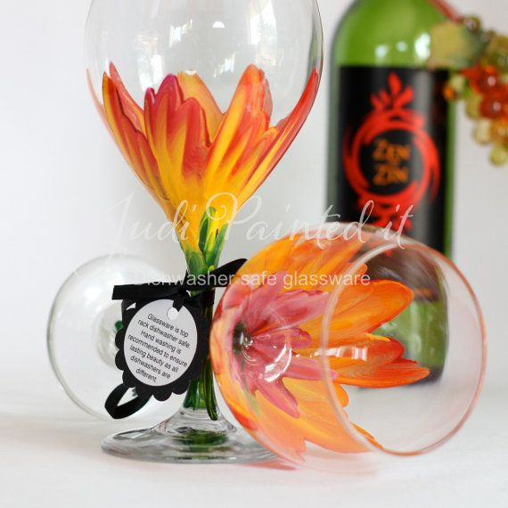 Orange and Red tropical Hibiscus hand painted wine glasses by Judi Painted it. Dishwasher safe and personalization is FREE A set of two 20 oz wine goblets for $24. View and place orders at http://judipaintedit.com or http://www.etsy.com/shop/JudiPaintedit?ref=top_trail