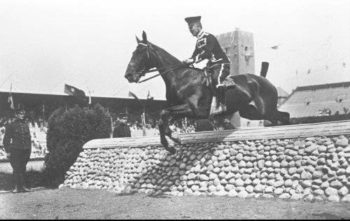 Prior to 1952 Olympic riders were commissioned officers. Until 1952 women and civilians were not permitted to take part in the Olympic Equestrian events.  This picture is of Heinrich von Moers of Germany in the show jumping phase of the Three Day Event competition during the 1912 Olympic Games in Stockholm, Sweden. Now a very important part of show jumping dress is a helmet!