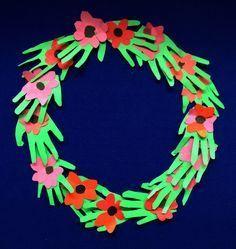 Classroom Poppy Wreath - (Every kid trace their hands, and make a classroom wreath for Remembrance Day!)