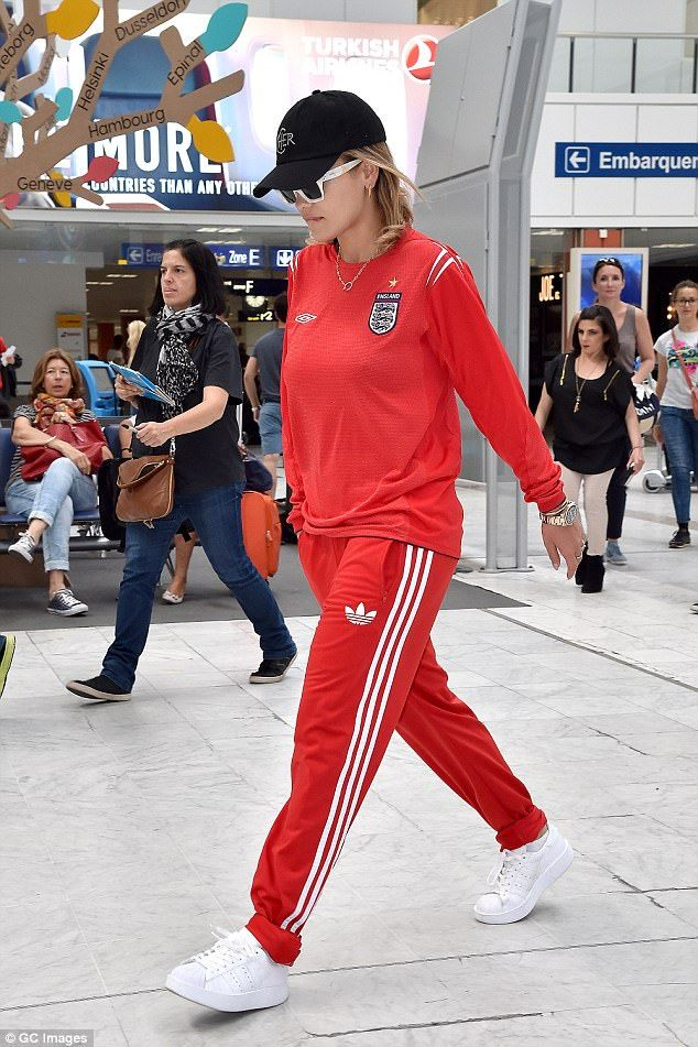 Low-key: Rita was dressed down in the red sportswear, teaming classic Addias bottoms with a sporty top