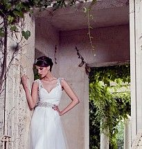 Demi Couture V-neck draped bodice with bias cut half circle tulle skirt overlay and stunning diamante shoulder detail.