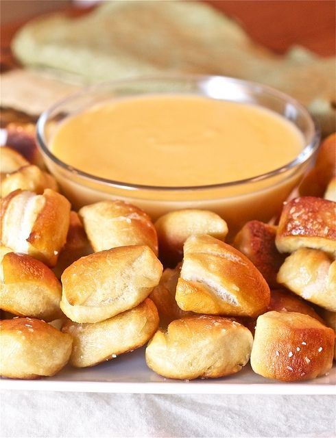 Soft+Pretzel+Bites+with+Cheese+Sauce  Ingredients:  1+1/2+cups+warm+(110+to+115+degrees+F)+water 1+tbsp+sugar 2+tsp+kosher+salt 2+1/4+tsp+instant+yeast 22+ounces+all-purpose+flour,+approximately+4+1/2+cups 2+ounces+unsalted+butter,+melted Vegetable+oil 10+cups+water 2/3+cup+baking+soda 2+tbsp+butter,+melted Pretzel+or+Kosher+salt Ins