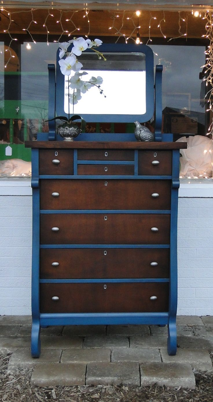 Tall Drink of Water. One of my favorite types of chests to find, this one has an attached mirror (mirror shows a little age) and I love the tiny little top drawers! Painted in a deep blue with dark stained top and drawers, new antique looking hardware.The mirror is attached in the back so it can easily be removed without damage to the top. Modern Vintage