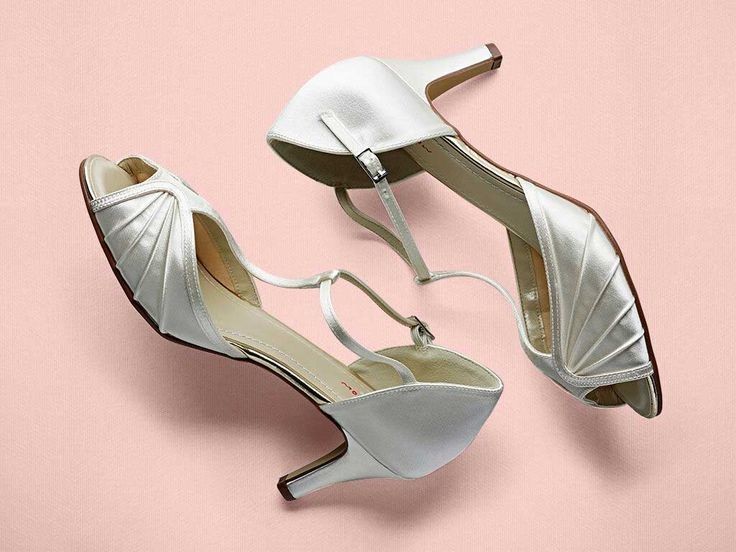 The Katy wedding shoe is a vintage T-bar in Ivory Satin with a mid-height heel and classy pleated detail on the upper. Did you know you can have these shoes hand coloured to any shade? Click on the Colour Studio tab for more information.