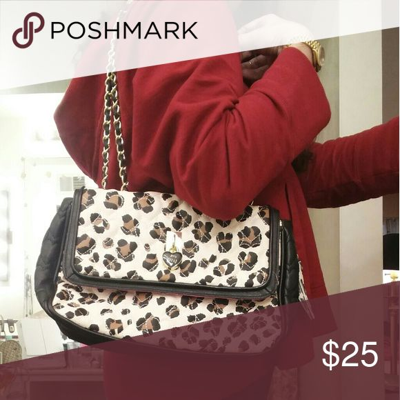 ❌HOLD❌NWOT Betsey Johnson quilted leopard purse NWOT Betsey Johnson quilted leopard purse with gold chain straps.  Never carried, brand new.  Really cute well-marked bag even has a matching bag charm.  Sexy cute purse.  11x8x4  Price firm unless bundled.  Thanks! Betsey Johnson Bags Shoulder Bags