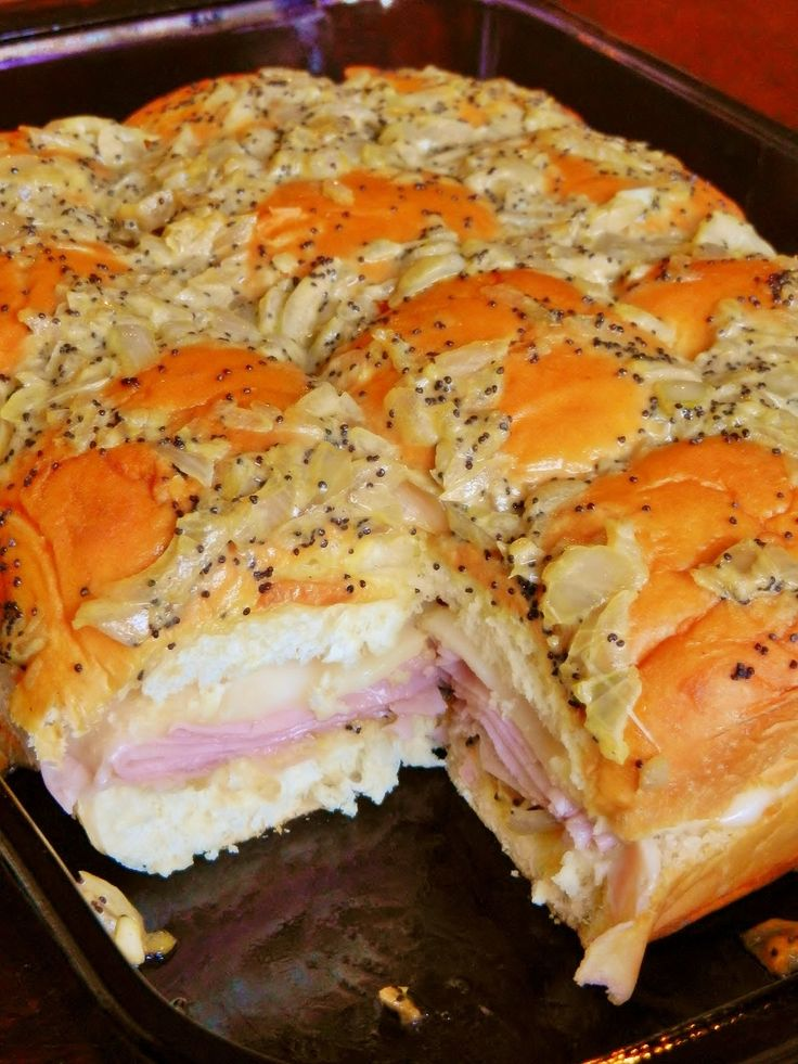 Baked Hawaiian Roll, Ham, and Swiss Sandwiches.  Looks so good!!