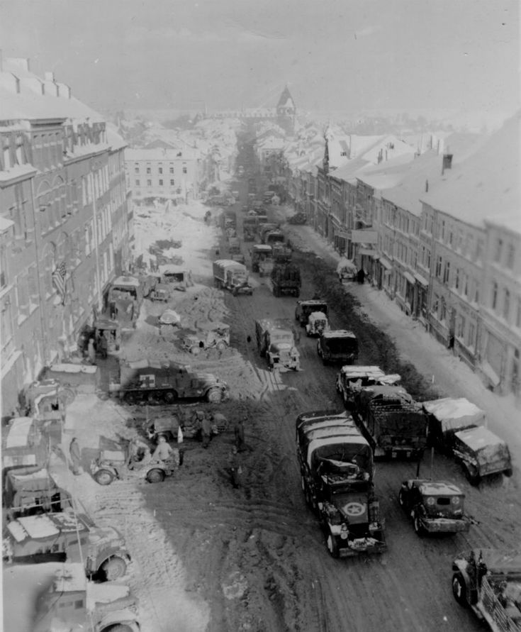 Looking north into Bastogne, Belgium shortly after the liberation of the city during the Battle of the Bulge - January 22, 1945. Note the heavy vehicle traffic