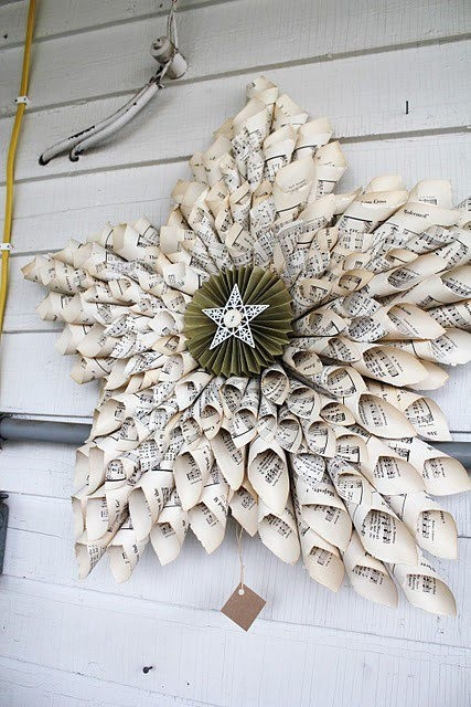 Holiday star made from coiled up sheet music.
