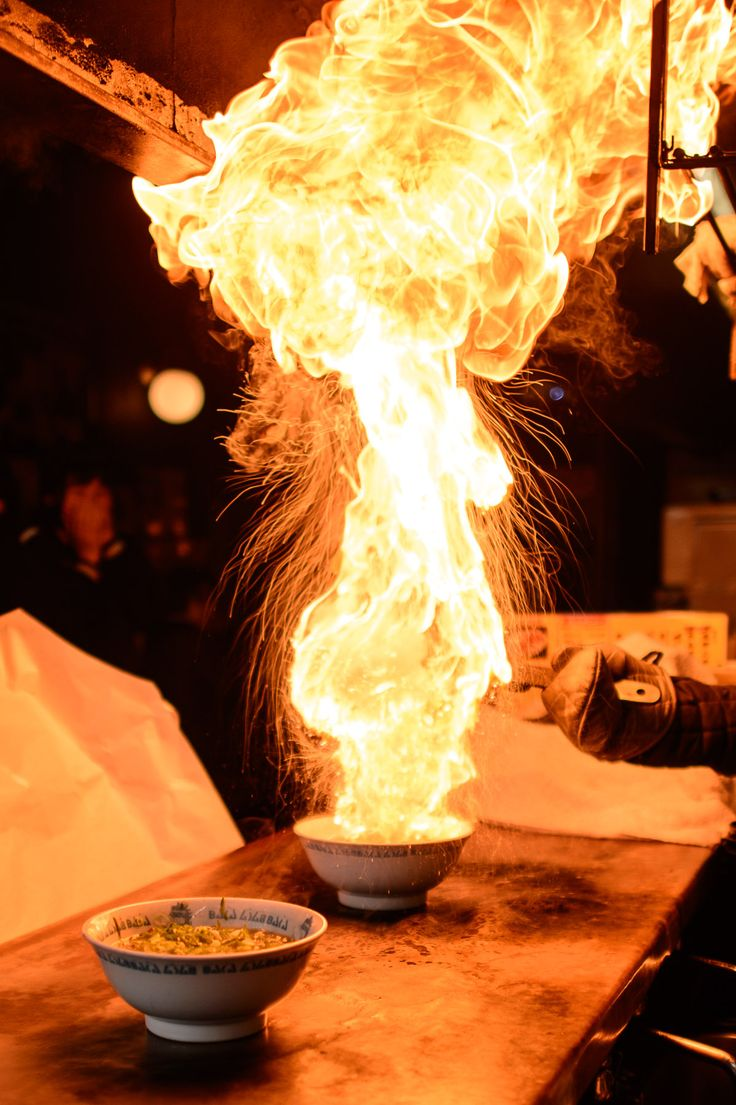 Fire Ramen: Men-Baka Ramen Restaurant (めん馬鹿) -- Kyoto, Japan: Scalding oil is added to a bowl of noodles and green onions before it's set on fire. Image credit Jeffrey Friedl #Ramen #Flaming
