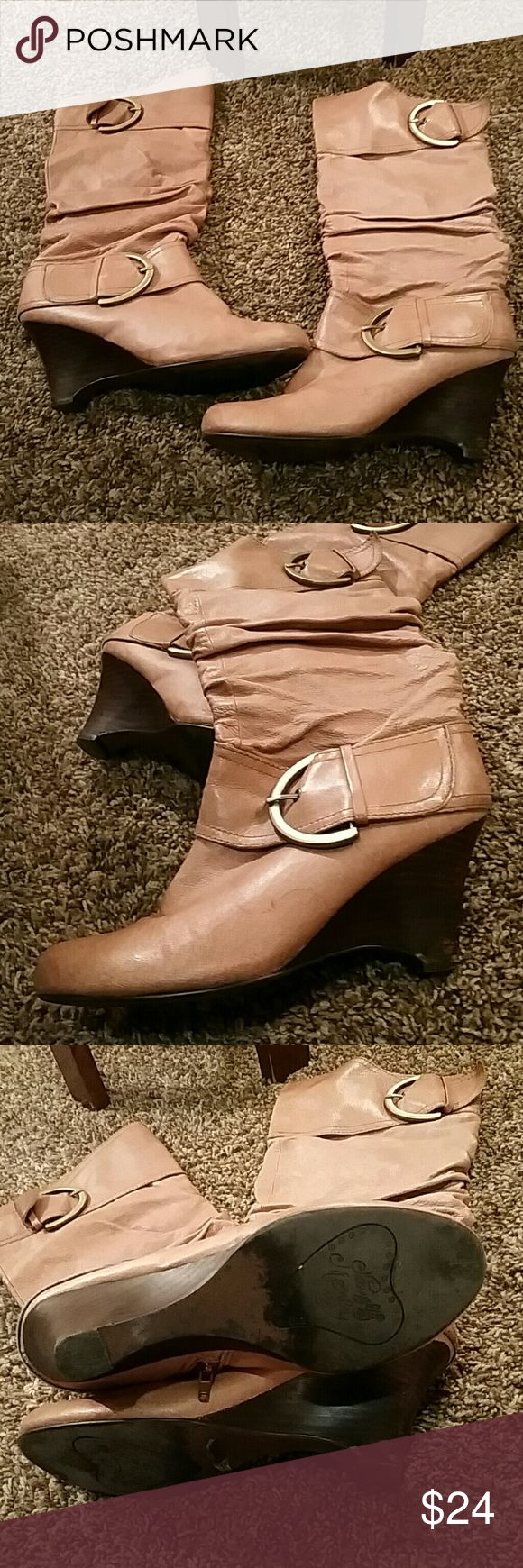 Beautiful Brown heeled boots They're in really good condition and the zippers on the inside make it easy to get your foot in naughty monkey Shoes Heeled Boots