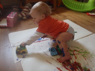 Painting with toy cars.