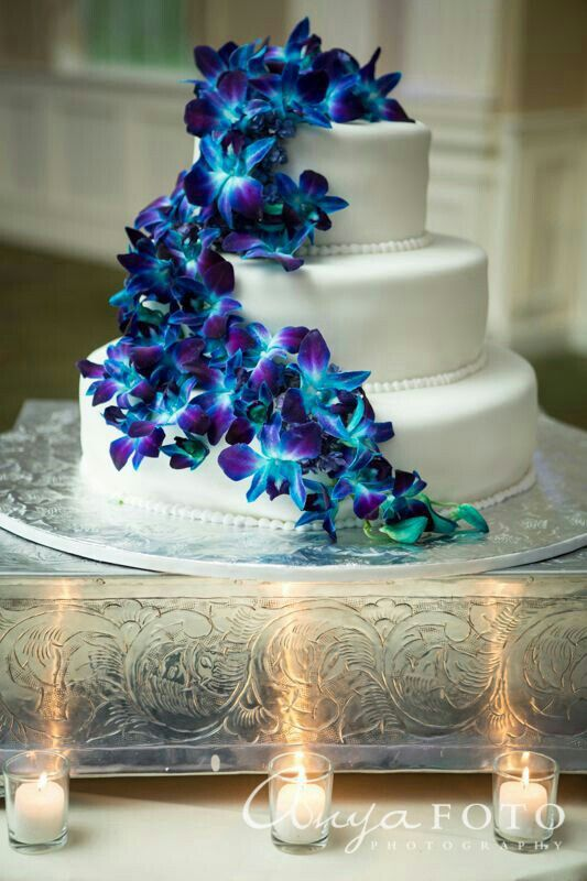 """Three Tier White Heart Shaped Wedding Cake Featuring Fresh, """"Cascading"""" Purple/Blue/Teal Dendrobium Orchids..........................."""