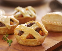 Serve these Tenderflake Mini Beef Pot Pies at your party. They're full of pie-licious goodness.
