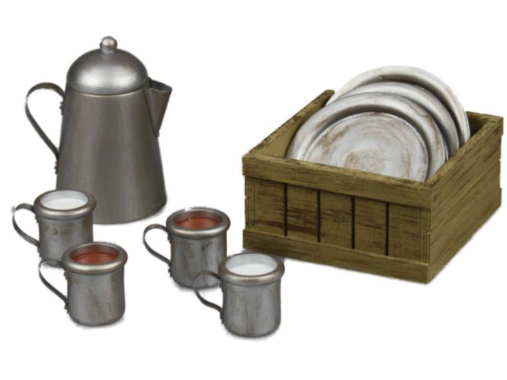 """This Little House on the Prairie® set features an 11 piece tin-inspired dinnerware collection, 4 plates, a coffee pot, 2 cups of coffee for Ma and Pa, 2 cups of milk for Mary and Laura, a sack of coffee, and a wooden crate to store them all. The perfect size for 18"""" dolls!"""