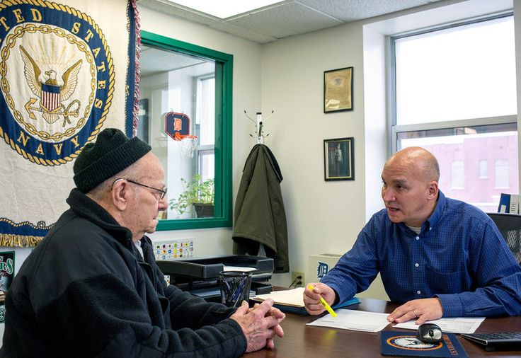 Indiana's Veterans Service Officers Help Vets Get More Benefits : NPR  Grant County Veterans Service Officer Bob Kelley, right, works with World War II Army veteran Frederick Kern at the Grant County Government Building in Marion, Ind., on Monday.