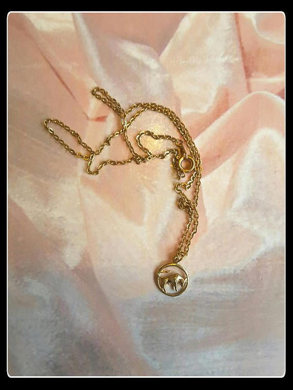 Vintage tiny solid gold Aries star sign pendant