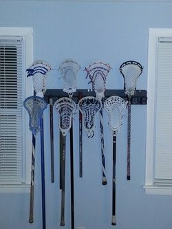 Lacrosse Stick Storage - wall mounted tool rack from Home Depot