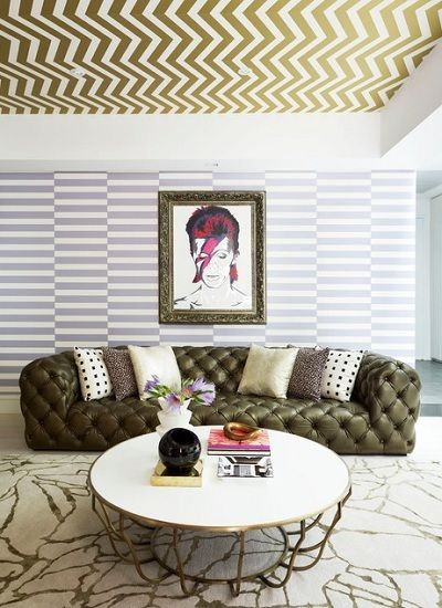 Literally, we love everything about this space. The wallpaper, the | c e i l i n g p a p e r | , the rug, the quilted sofa, all of it. We are loving this new adventurous take on mixing patterns. By taking a simple variegated stripe and pairing it with a chevron ceiling treatment, instant visual interest is achieved. Now, we understand that this might not be everyone's cup of tea, but what we can agree on is how the mixture of textures and finishes can take a room from Safe Sally to Designer…