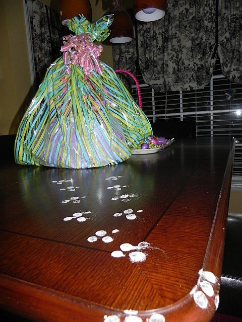Bunny Tracks leading to her Easter basket! Use bottom of 2 liter coke dipped in flour, powdered sugar. If kids are bad leave a trail of raisins as poop.
