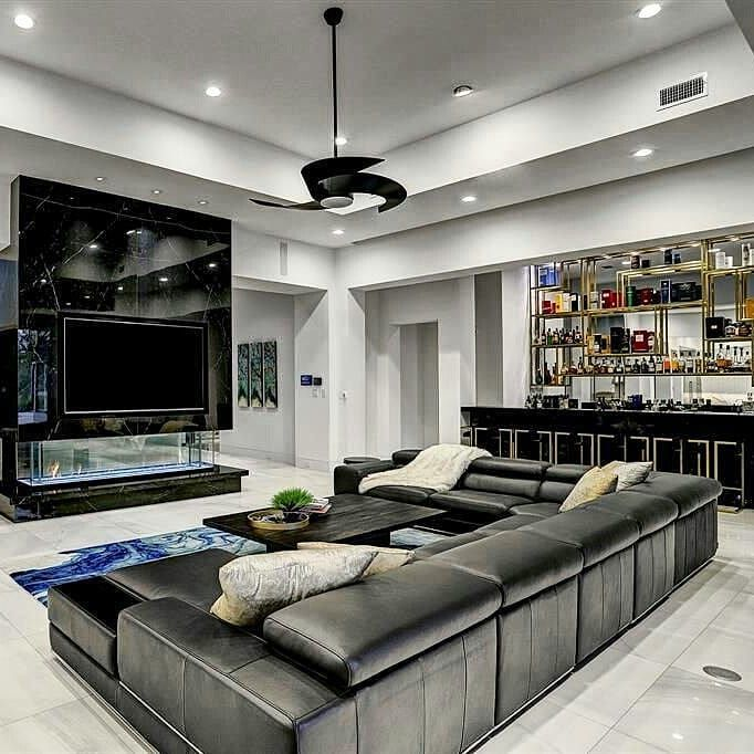 Family Room With Wet Bar And Custom Media Center Above A 3 Sided Fireplace Home Homes Modern Living Room Interior House Interior Decor Family Room