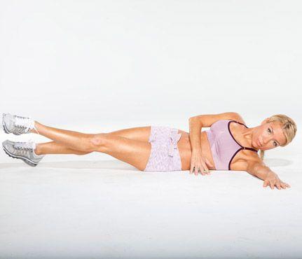 Gwyneth Paltrow's Arm and Ab Moves:Step 1 - Lie faceup with legs extended. Roll onto left side and extend left arm in front of you, right arm across torso, fingertips to floor for support. Lift left (bottom) leg and cross left leg over right. Keep right foot pointed and heel on floor the entire time.