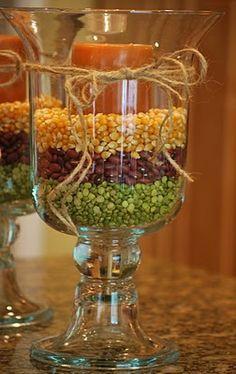 """insert candle into empty hurricane glass - this """"Fall"""" project includes split peas, small red beans and corn kernels. For a more """"Halloween"""" look - it suggests red lentils, white northern beans and black beans. This would look nice with the candle and/or ribbon - any color combination would work - there are tons of possibilities ; )"""
