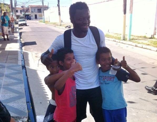 The Ghana player who asked to visit the poor neighborhood surrounding the stadium (and gave away money). | 11 World Cup Stories That Will Make You Smile (And Cry)